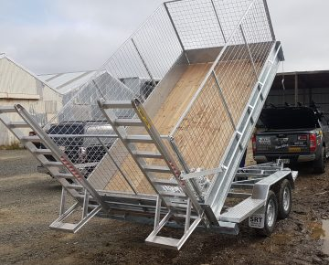 10.5 X 5.5 Tip trailer with cage